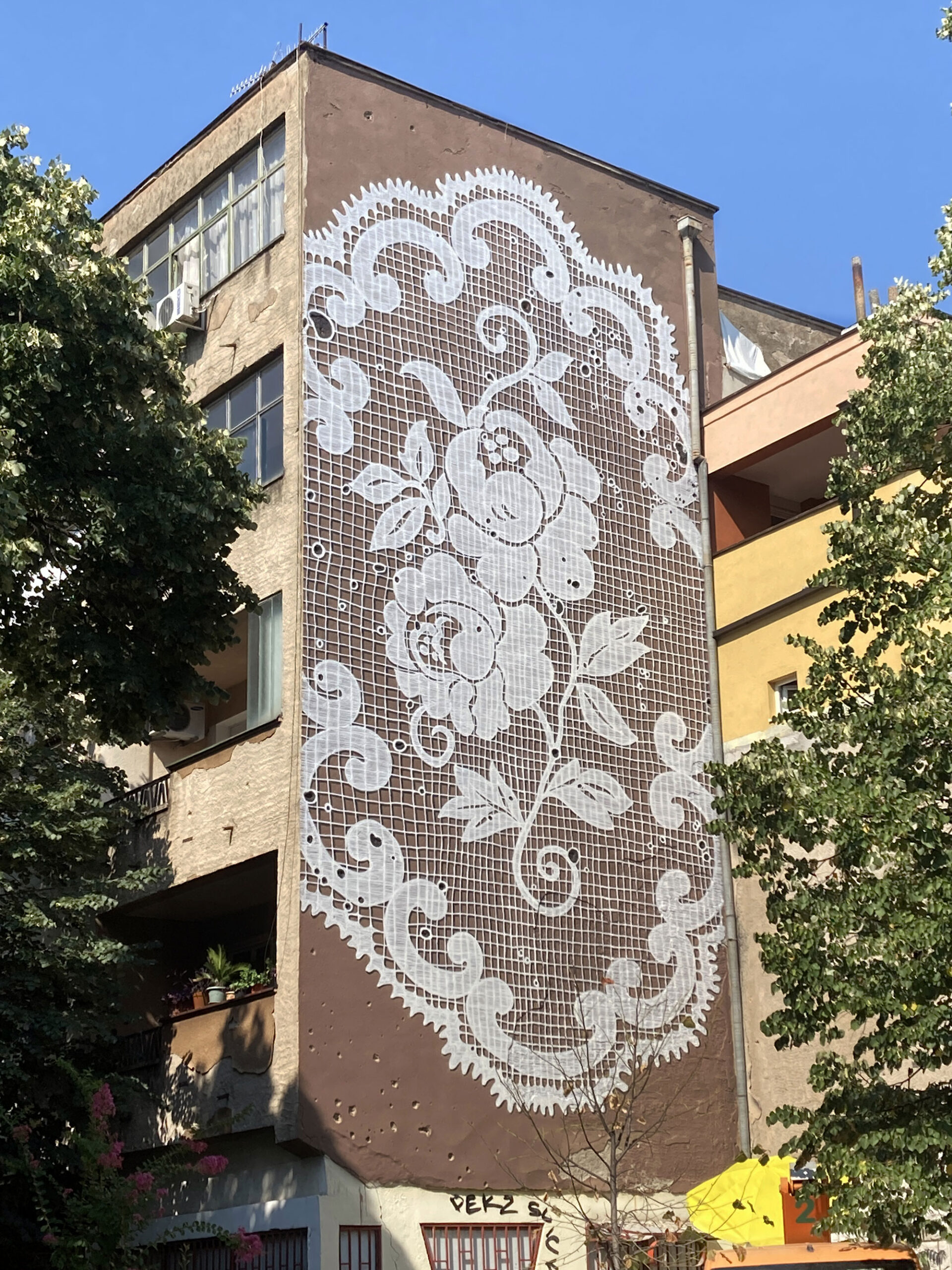 ornate-murals-by-nespoon-cloak-blank-facades-in-traditional-lace-patterns